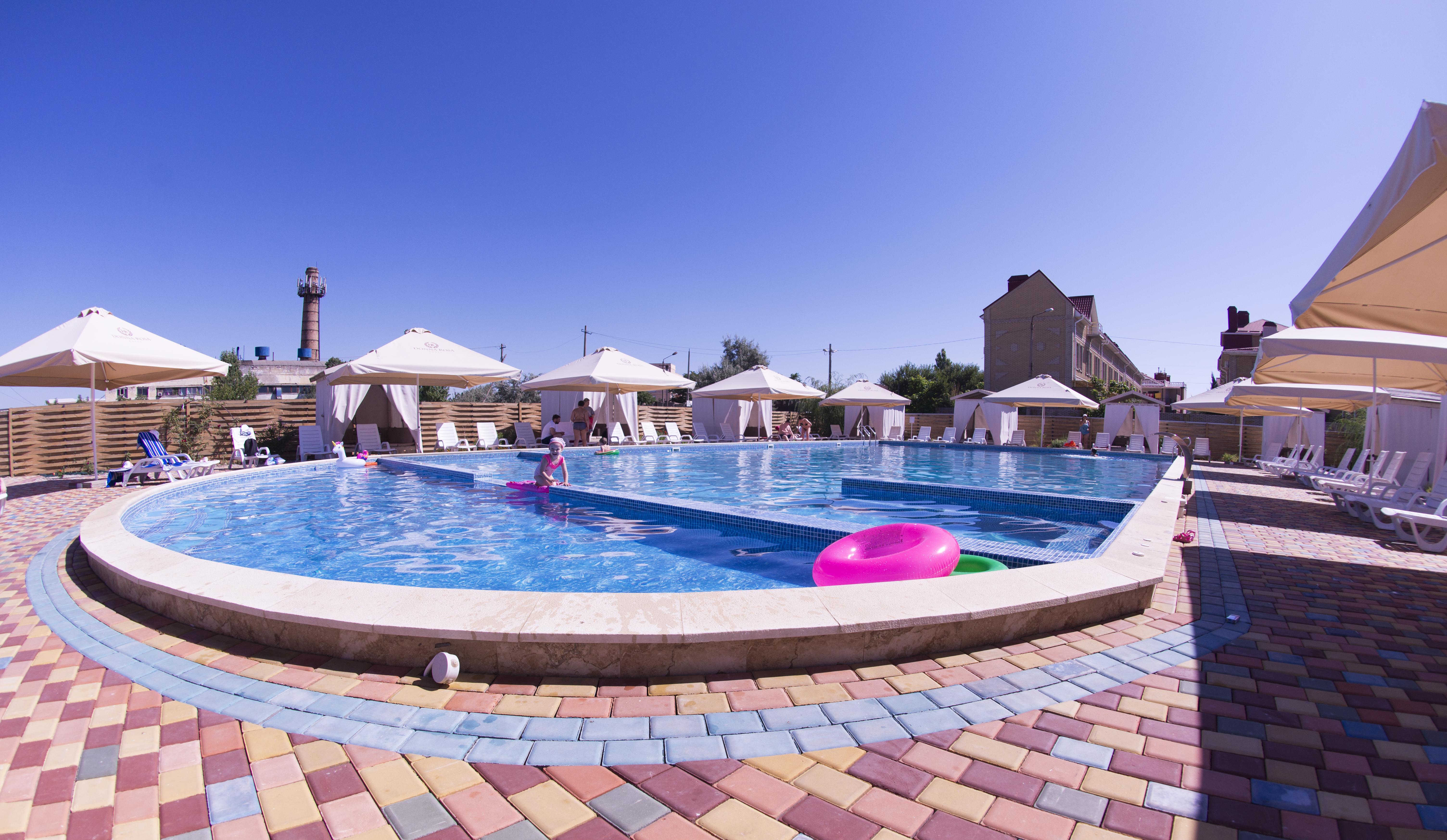 Отель для отдыха с детьми с подогреваемым бассейном
